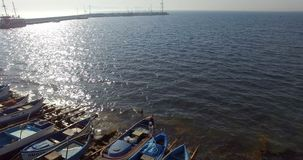 Autumn sun over the cold waters of the Pomorian bay in Bulgaria stock video footage