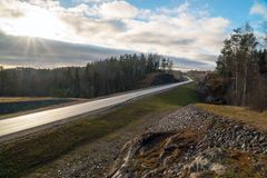 Autumn Sunny landscape of the highway A-121 Sortavala in Karelia. Russia. Autumn landscape highway A-121 Sortavala in Karelia. Russia stock images