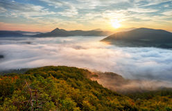 Autumn sunrise above mist and forest landscape, Slovakia, Nosice Royalty Free Stock Images