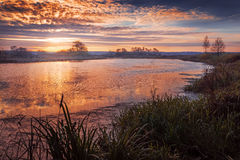 Autumn sunrise on the river. In October day Stock Images