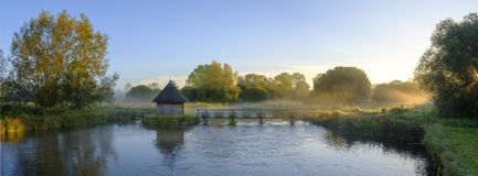 Free Autumn Sunrise With Mist On The Eel House Traps On The River Test Near Longstock, Hampshire, UK Royalty Free Stock Photos - 147274018
