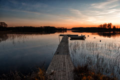 Autumn sunset. At a lake in Ostergotland, Sweden Royalty Free Stock Photos