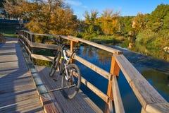 Autumn sunset bike on bridge Parque de Turia Royalty Free Stock Images