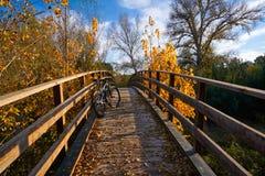 Autumn sunset bike on bridge Parque de Turia Stock Image