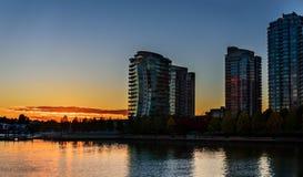 Autumn sunset in the city near the ocean royalty free stock photos