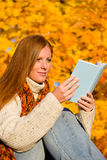 Autumn sunset country - woman read book Royalty Free Stock Photos