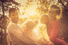 Autumn sunset. Funny family. stock photography