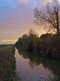 Autumn sunset on the Great Fen Project. Photo taken on an autumn day at sunset of the bridge over Great Raveley Drain, at the entrance to Woodwalton fen Stock Photos