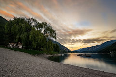 Autumn Sunset , Ledro lake. Lake front in Ledro Valley, Trentino Italy at sunset stock photos