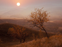 Autumn sunset mountain. Distant hills sunset in autumn scenery royalty free stock photo