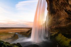 Autumn Sunset over a Majestic Waterfall in Iceland stock photos