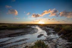Autumn sunset over the popular Norfolk coast marshes stock image