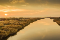 Autumn sunset over the river mouth Stock Photography