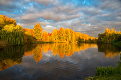Autumn sunset in the Park by the pond. Royalty Free Stock Photos
