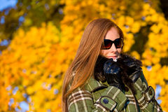 Autumn sunset park - red hair woman fashion Royalty Free Stock Photo