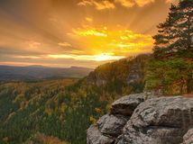 Autumn sunset view over sandstone rocks to fall colorful valley of Bohemian Switzerland. Sandstone peaks in forest. Royalty Free Stock Photos