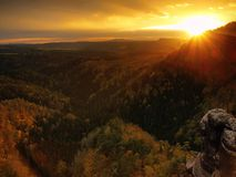 Autumn sunset view over sandstone rocks to fall colorful valley of Bohemian Switzerland. Sandstone peaks in forest. Royalty Free Stock Image