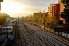 Autumn sunset, view of train tracks near Alcala de Henares stati. Sunset view of train tracks near Alcala de Henares station, Madird, Spain Royalty Free Stock Photos
