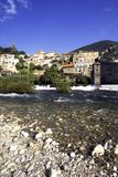 Picturesque France - Roquebrun. Autumn sunshine on the idyllic hillside village of Roquebrun on the River Orb, Herault, Languedoc-Roussillon, France stock image