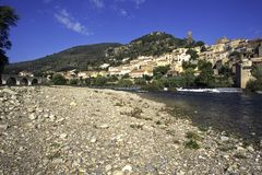 Picturesque France - Roquebrun. Autumn sunshine on the idyllic hillside village of Roquebrun on the River Orb, Herault, Languedoc-Roussillon, France stock photo