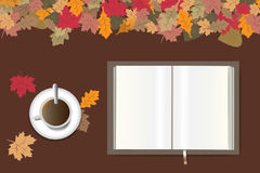 Autumn table design with open book Royalty Free Stock Photo
