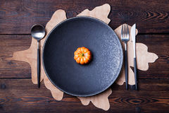 Autumn table place setting with pumpkin Top view. Autumn table place setting with pumpkin, thanksgiving, halloween decoration. Top view. Copy space Stock Photos
