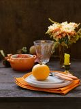 Autumn table setting. With pumpkin and flowers stock image
