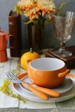 Autumn table setting. With pumpkin and flowers stock photo