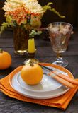 Autumn table setting. With pumpkin and flowers royalty free stock images