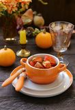 Autumn table setting. With pumpkin and flowers stock images