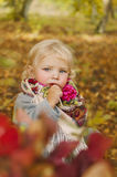 Autumn Tale. Beautiful girl in fairy forest, eats a lollipop Royalty Free Stock Photo