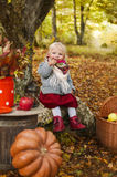 Autumn Tale. Beautiful girl in fairy forest, eats a lollipop Royalty Free Stock Images