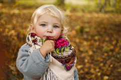 Autumn Tale. Beautiful girl in fairy forest, eats a lollipop Royalty Free Stock Image