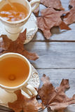 Autumn tea background. Green tea in vintage mugs on wooden table with dry fall leaves. Copy space background Stock Photos