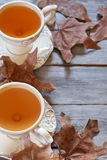Autumn tea background. Green tea in vintage mugs on wooden table with dry fall leaves. Copy space background Stock Photography