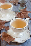 Autumn tea. Green tea in vintage mugs on wooden table with dry fall leaves. Selective focus Royalty Free Stock Photo