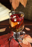 Autumn tea with lemon, spices in glass cup Royalty Free Stock Photography