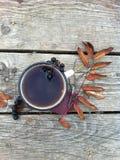 Autumn tea mug Royalty Free Stock Image