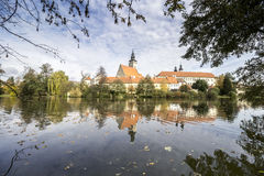 Autumn Telc Town. Fall City in Czech Republic. Bohemia in Europe. Castle Reflected in Lake royalty free stock photo