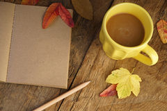 Autumn template with dried leafs and coffee Royalty Free Stock Photos
