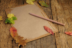 Autumn template with dried leafs and notebook Royalty Free Stock Photography