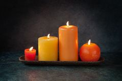 Autumn thanksgiving candles. Autumn thanksgiving decor with burning candles royalty free stock images
