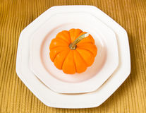 Autumn Thanksgiving dinner table setting with decorative pumpkin Royalty Free Stock Image