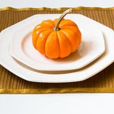 Autumn Thanksgiving dinner table setting with decorative pumpkin Royalty Free Stock Photos