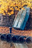 Boat on the shore of the lake. Autumn theme, boat suspended on the shore of the lake Stock Images