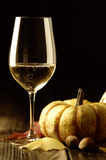 Pumpkins and autumn leaves with white wine Royalty Free Stock Photography