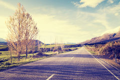 Autumn Themed Country Road Mountain Range Concept Stock Photography
