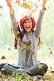 Autumn throw woman Royalty Free Stock Photography