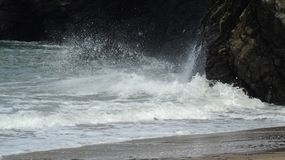 Autumn tide. High Tide coming in and splashing on the rocks Royalty Free Stock Photography