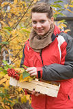 Autumn Time. Portrait of teenage girl with basket of autumn leaves and berries Stock Image